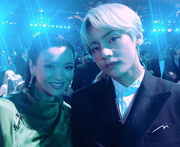V of BTS and Serena McKinney Göransson, Wife of Grammy Winner, Ludwig, Pose for an Iconic Photo